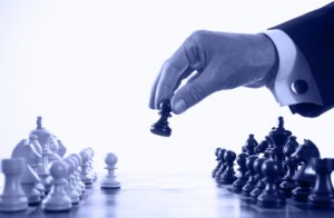 businessman playing chess game blue tone